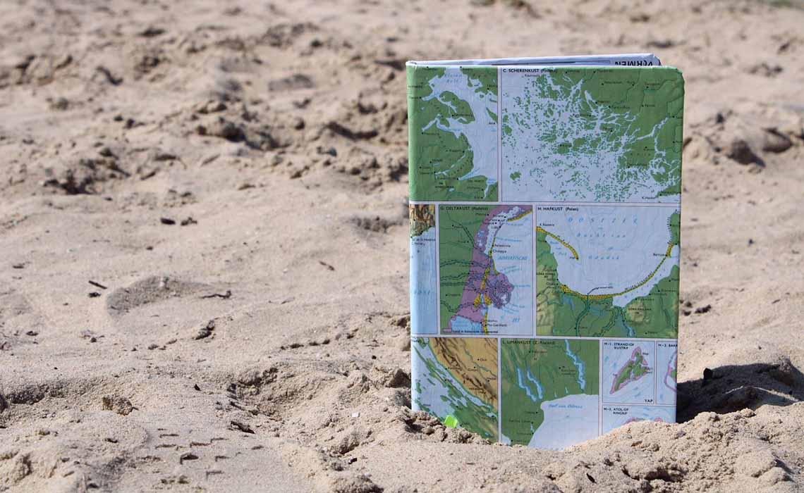 Signed notitieboeken wereldkaart - Strandfoto - Travelvibe